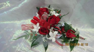 Red roses and white stephanotis