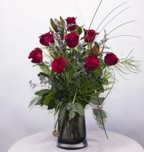 Dozen Red roses in smoked vase